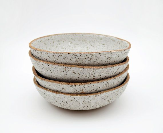 This listing is for a SET OF 4 rustic bowls that have been hand formed, by me, from earthy, textured stoneware clay. After bisque firing they have
