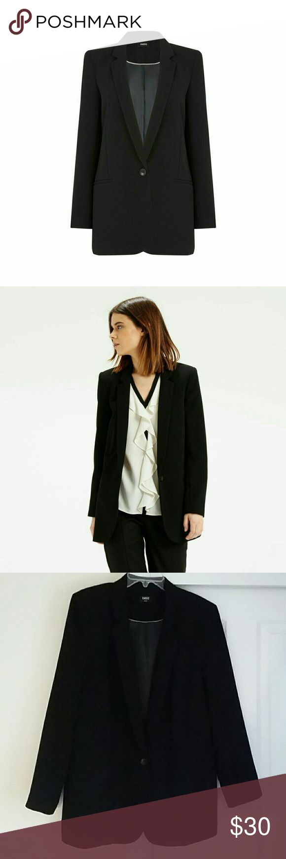 """Black Oasis Textured Ultimate Blazer Out of stock in stores! """"They say simplicity is key. Just take a look at this timeless tailored jacket, all clean lines with a contemporary cut."""" 100% Polyester, Dry Clean. One button, faux front pockets. UK 16, EU 42 = U.S. Large (10-12) Bust: 38-40"""", Waist: 31-33"""", Hips: 40-42"""". Worn just once, like new! Oasis Jackets & Coats Blazers"""