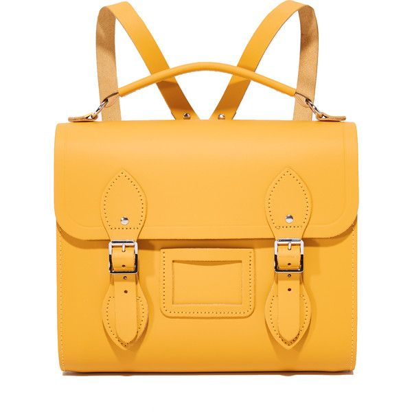 Cambridge Satchel Barrel Backpack ($255) ❤ liked on Polyvore featuring bags, backpacks, mustard, yellow leather bag, colorful backpacks, mustard yellow bag, day pack backpack and multi colored backpacks
