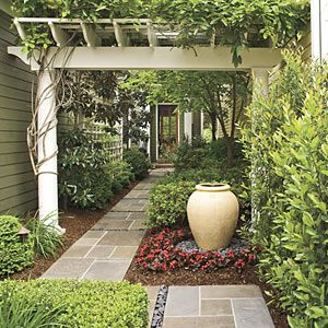 Entrance needs definition I like the wide pergola and the hedge planting would work too, let's do this without the ashar pattern walk