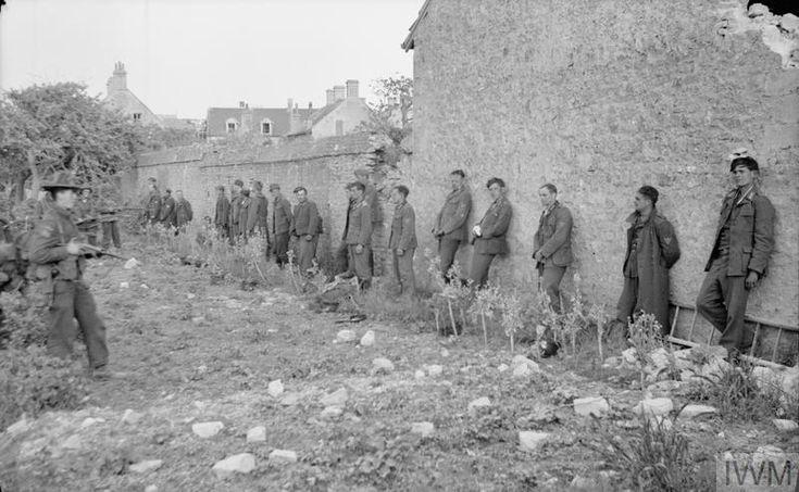 German prisoners captured by Canadian troops of 1st Battalion, North Shore Regiment, Langrune-sur-Mer, 7 June 1944.