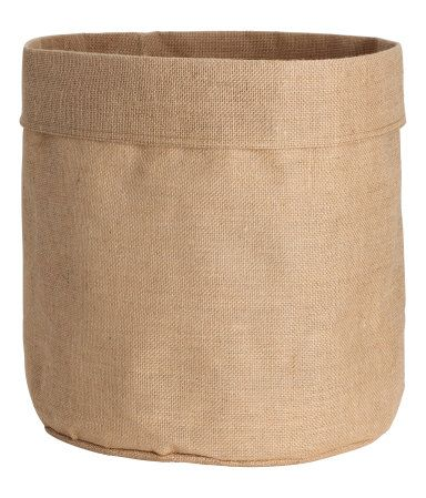 Natural. Large jute storage basket with laminated inside. Diameter 15 3/4 in., height 15 3/4 in.