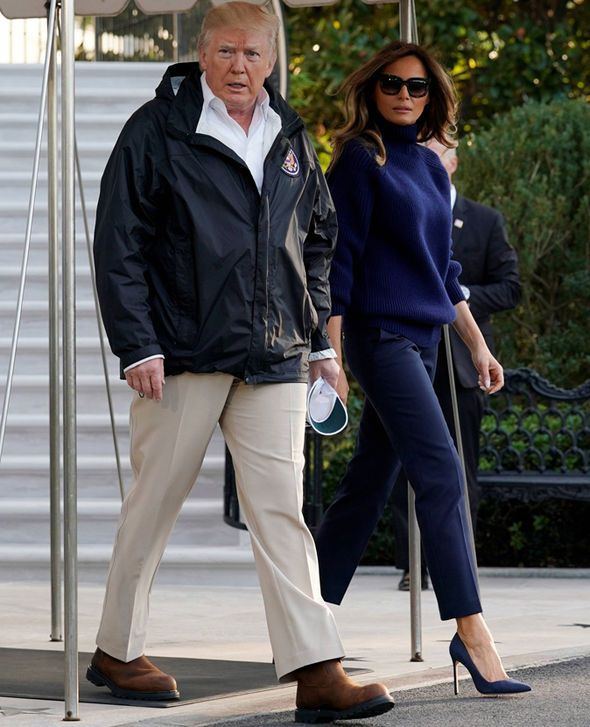 Oct 5th, 2017. President Trump and Melania Trump on their way to Puerto Rico. Melania looked beautiful wearing a Navy Blue Turtle Neck Sweater, Navy Blue Cigarette Jeans and Navy Blue Stilettos.