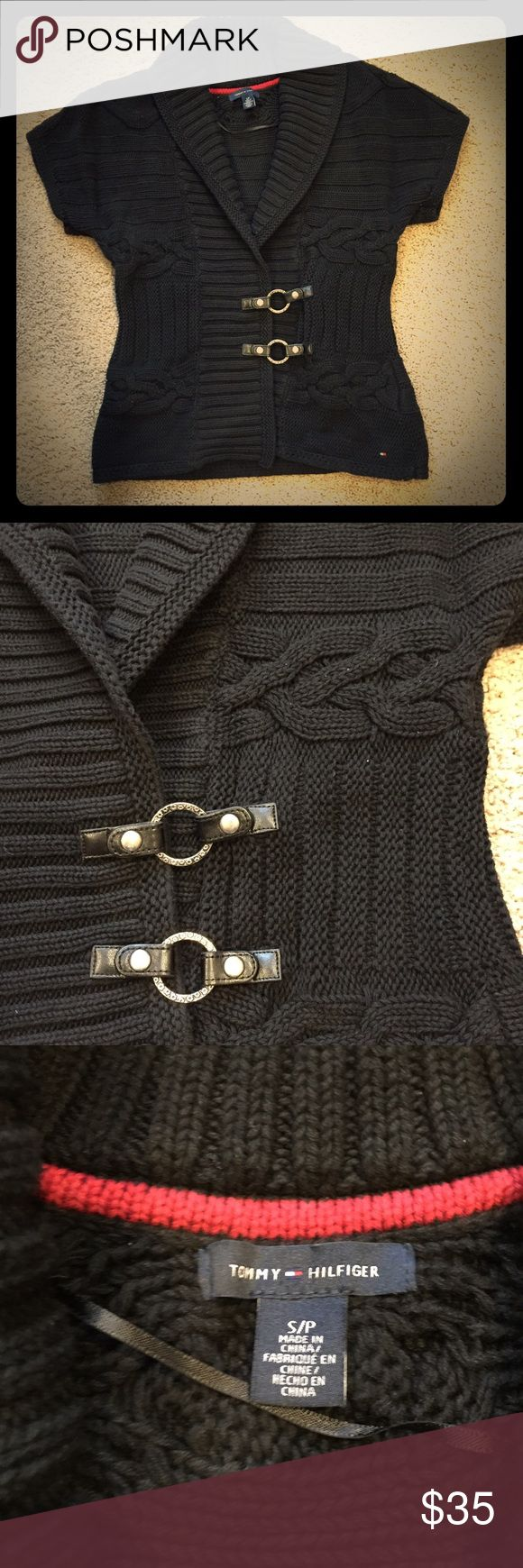 Black Tommy Hilfiger sweater Black Tommy Hilfiger sweater with silver accents!  This sweater looks great with any color of top underneath and is in excellent condition! Tommy Hilfiger Sweaters