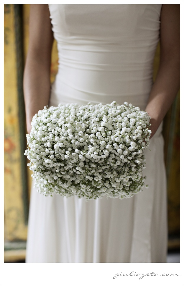 baby's breath makes a very feminine statement, this is unusual because it isn't a bouquet, it's a muff!! www.celebrationsbykat.com