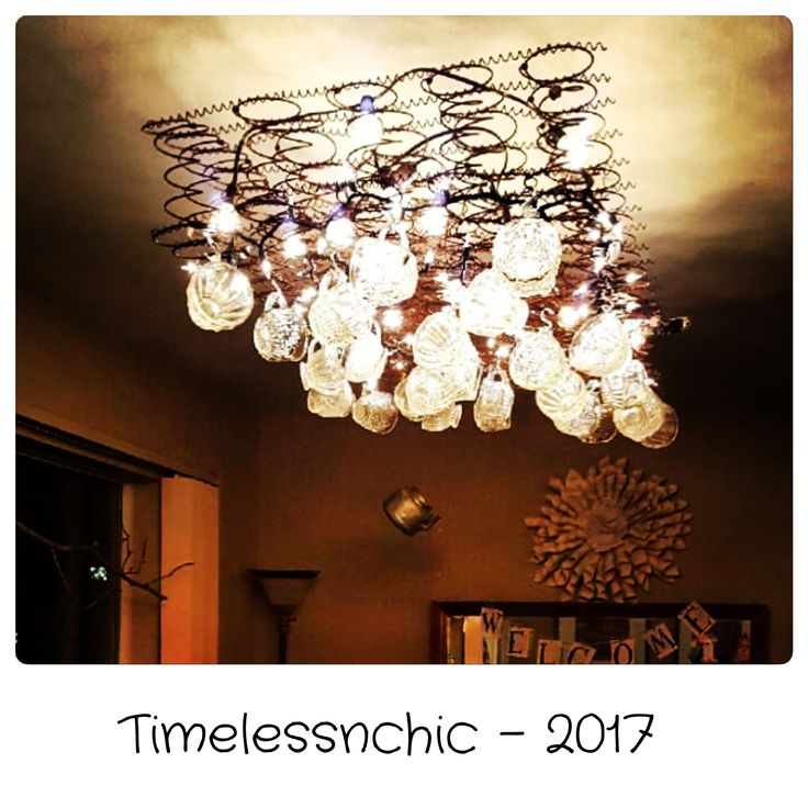 """My latest repurpose for the salon where I have some of my goodies! A rustic """"chandelier"""" from a salvaged bed spring, lights, and punch bowl cups! Trying to create an unforgettable, inviting, unique setting!!! Hope you dig it! Thanks for looking! -Courtney"""