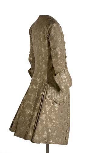 Frockcoat, ca.1740, Spain. Male silk brocade jacket with silver floral decoration with small grenades, occupying the entire surface of the piece. Fitted body and wide skirts, closes in the front with buttons covered with rich silver plates. INVENTORY: MT14796 Museodeltraje.mcu.es