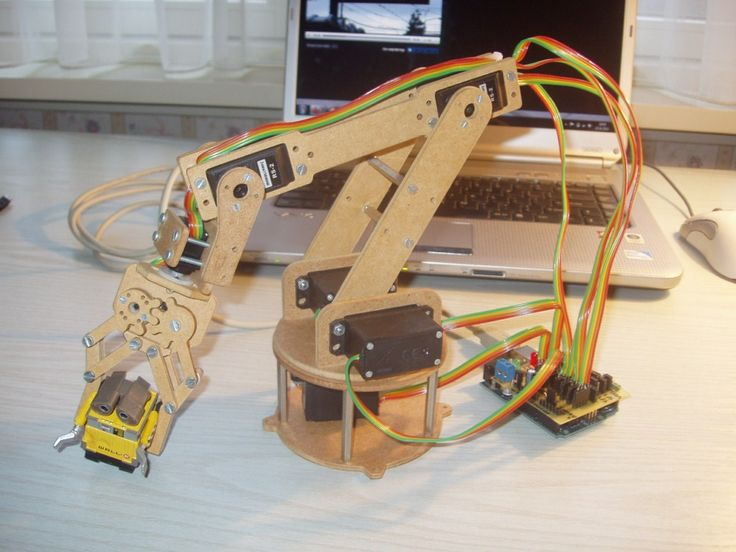 [jjshortcut] has created an easy to make robot arm that has 6 degrees of freedom. There is not much to it, the frame is made out of 4mm thick hardboard, hobby servos provide the power and a handful ...