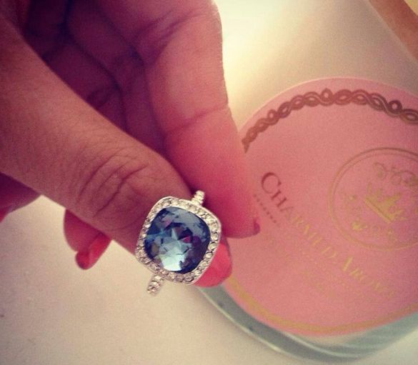 Swarovski ring uncovered from Charmed Aroma candles! Get yours now! Everyone is a winner! Candles are $25/each.