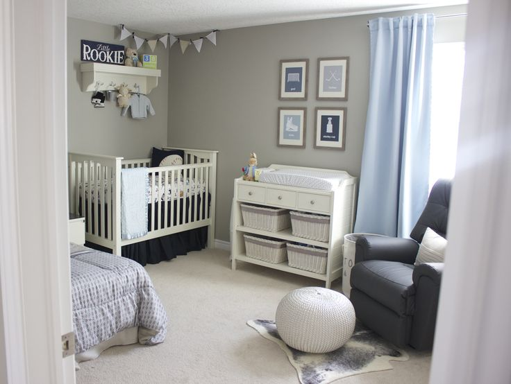 A blue and gray sports inspired nursery. My style is clean and contemporary. I like calm spaces and I incorporate many DIY touches into my decorating.