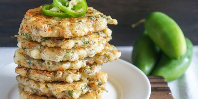 Spicy Cilantro Corn Cakes with habanero jack cheese, fresh jalapeño, cilantro, and lime juice are a dinner party favorite! Make a batch in advance, freeze, and reheat when you're ready to eat.