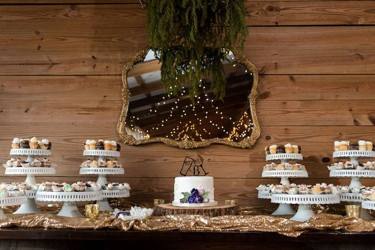 Rustic Cupcake Wedding Dessert Table on Sequin Specialty Linen | Wedding Cupcake Table Ideas and Inspiration | Wedding Cupcakes by Alessi Bakery in Tampa FL | Photography by Caroline and Evan Photography