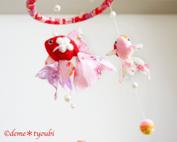 """This work name is """"Hina no tsurushi kazari"""". On the occasion of the Dolls' Festival on March 3, dolls made of cloths are hung at the tip of a string. The Doll's Festival is held on March 3rd. Families with girls celebrate March 3rd as a day to wish for their growth and happiness. This family event originally began in the Edo era. People displayed dolls and goldfish in the Edo era. So March 3 is a day of the goldfish in Japan. The size is approx 15inch×6.3inch"""