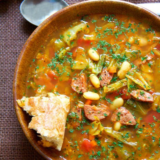 Farmhouse Cabbage Soup with Cannellini Beans and Kielbasa - A rustic and hearty soup that's sure to warm you and your crew.