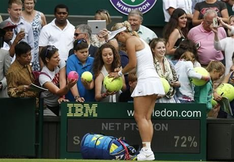 Sabine Lisicki of Germany sign autographs after winning her first round match against Julia Glushko of Israel at the All England Lawn Tennis Championships in Wimbledon, London, Tuesday, June 24, 2014. (AP Photo/Sang Tan) ▼20Jun2014AFP|Subbing for the champion, Lisicki advances http://bigstory.ap.org/article/subbing-champion-lisicki-advances #Sabine_Lisicki #The_Championships_Wimbledon_2014