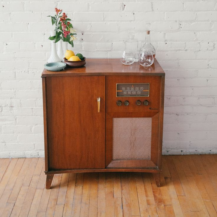 Vintage stereo cabinet turned bar table.