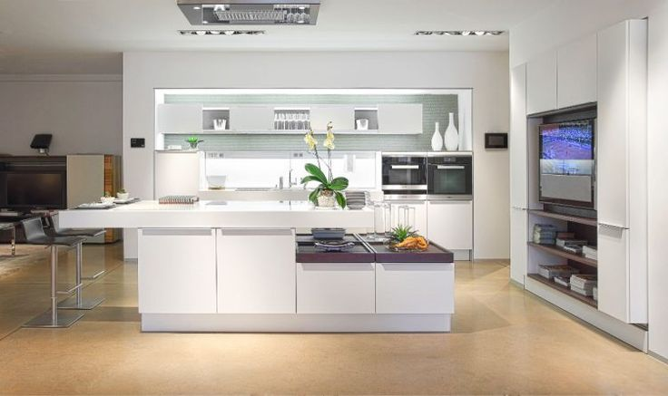 Ultra modern white kitchen painted concrete floors