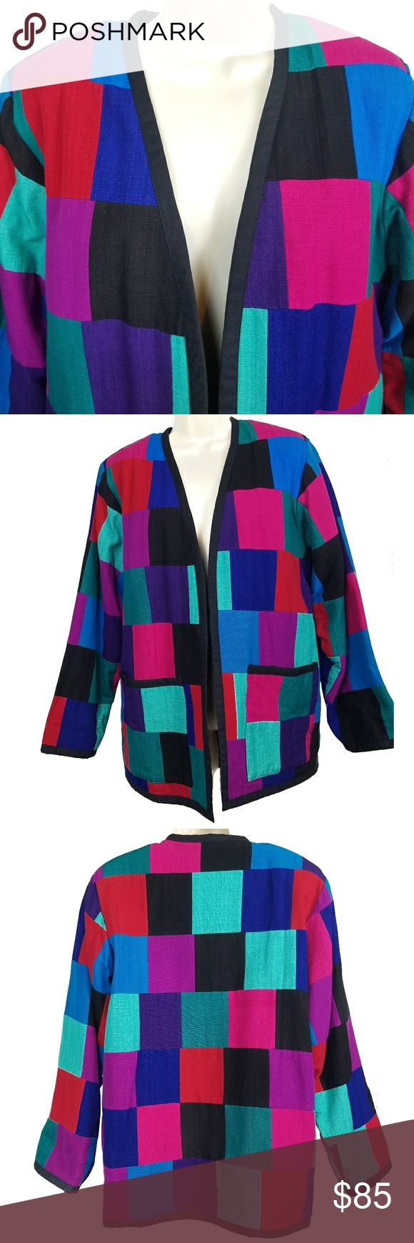 """Guatemalan Hand Woven Vintage Jacket This eye-catching, high quality jacket was hand woven in Guatemala of 100% cotton. It is very heavy and warm, with an outer shell of vibrantly colored patchwork and a black inner lining. It is from the late 1970s/early 1980s and a women's size small. There are several raised threads and a few spots in the inside shoulders from being hung in storage (see pictures #5 and #6 for examples). There are no rips, holes, or stains except as noted. The name """"Vick""""…"""