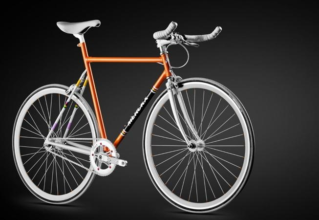 """The UMX-S is the new urban bike by Eddy Merckx. It's painted in """"Molteni"""" orange and has references to the three grand tours Eddy won, as well as some rainbow colors. It's a fixie, but it comes with normal brakes."""