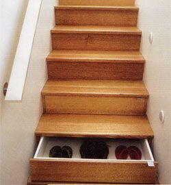 Drawers in the stairs. Blowing my mind. However, if left open it could cause a serious accident. (I think I am too clumsy to ever own this.)