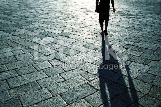 Shadow of single man on street royalty-free stock photo