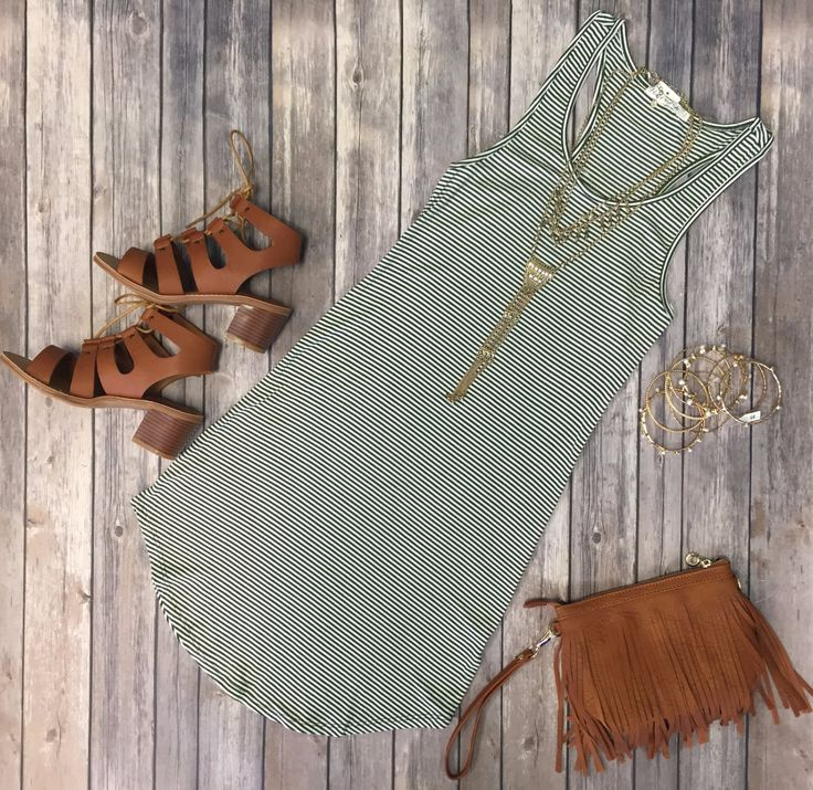 The Let's Have Some Fun Striped Tank Dress in Olive is stretchy, striped, and oh so fabulous! A great basic that can be dressed up or down! Sizing: Small: 0-3 Medium: 5-7 Large: 9-11 True to Size with