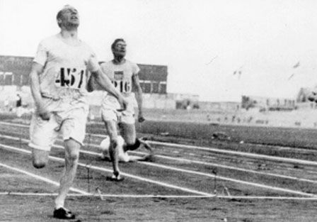 """Eric Liddell of Scotland wins the 400 meters final and the Olympic Gold medal~ 1924 Olympic Games~ Paris, France.  Liddell's life  would later become the basis for the Academy Award Winning movie """"Chariots of Fire"""" in 1980."""
