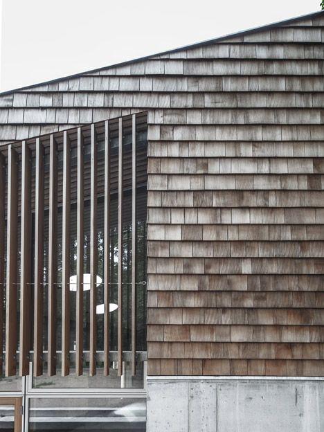 Shingled community centres by Sophus Søbye Arkitekter face into Copenhagen parkland.