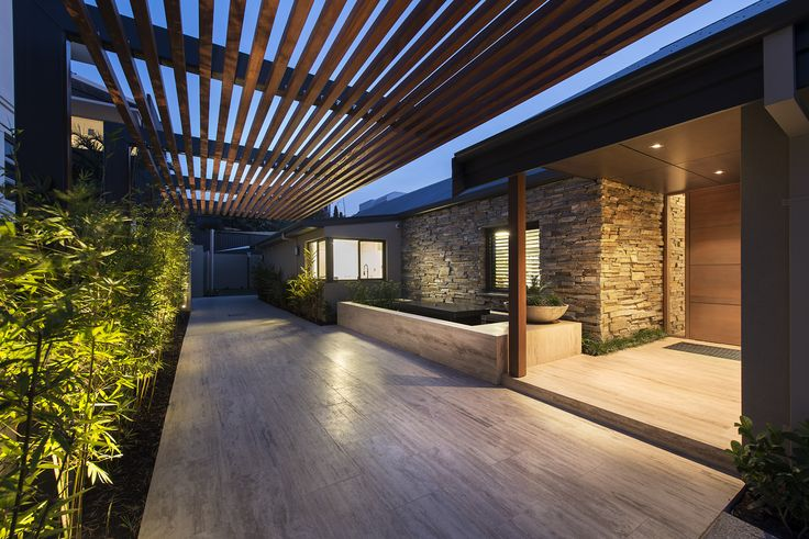 Stone driveway with feature cladding to exterior walls creates a luxurious feeling. Home designed and built by Urbane Projects, Perth