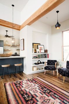 pretty wood ceiling beams and colorful rug!