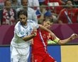 Russia's Andrei Arshavin, right,  and Greece's Giorgos Samaras challenge for the ball during the Euro 2012 soccer championship Group A  match between Greece and Russia in Warsaw, Poland, Saturday, June 16, 2012.