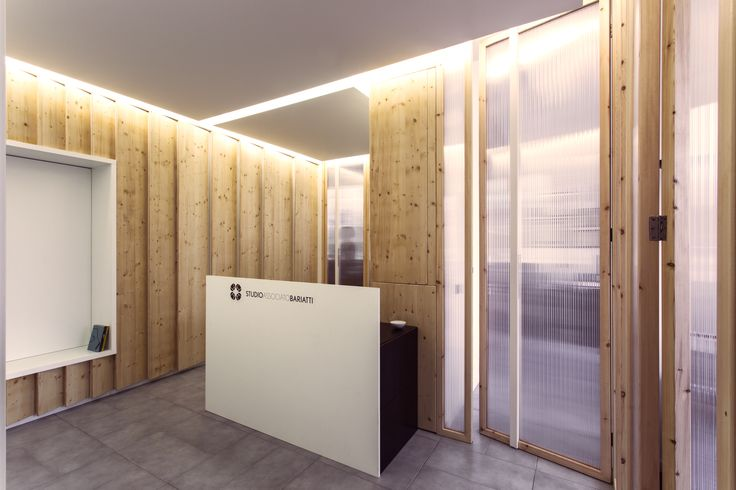 Law Firm Office in Milan by +R / www.piuerre,com / photo by Alberto Canepa / www.albertocanepa.com / #wood #custom #furniture #cupboard #zigzag #boiserie #interior #polycharbonate #office #translucent #materials #lighting #reception