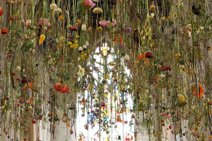 Breathtaking installation of suspended flowers delicately transforms London museum
