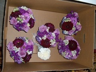 Bridesmaid bouquets by Vivianos for a purple-themed wedding planned by @you're The Bride Wedding Planner. Dresses were deep eggplant / plum purple. Flowers include dahlia, roses, stock, hydrangea, and orlaya (similar to Queen Annes Lace, but even more lacey) in shades from lavender to dark amethyst and white - the perfect accent for this elegant wedding! #VivianoFlowerShop