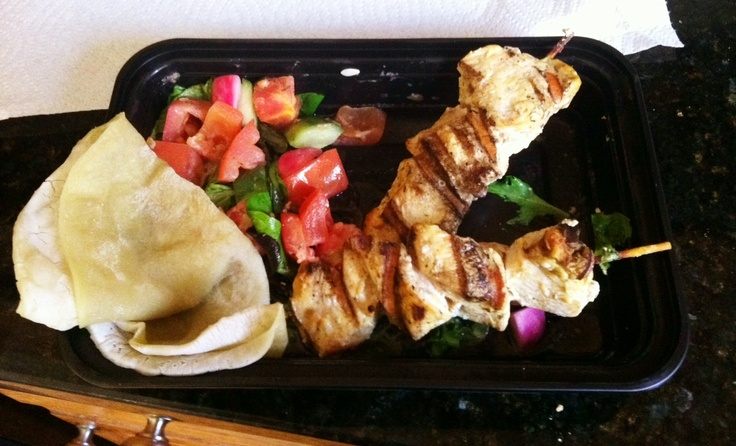 The grilled Chicken Souvlaki Wrap with Tomato Salad