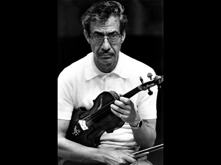 Luis Ximenez Caballero, conductor of the Orquesta Sinfónica de Xalapa... And violinist.