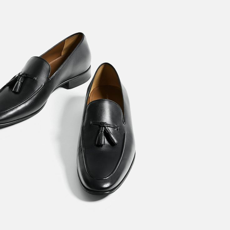black leather loafers with tassels