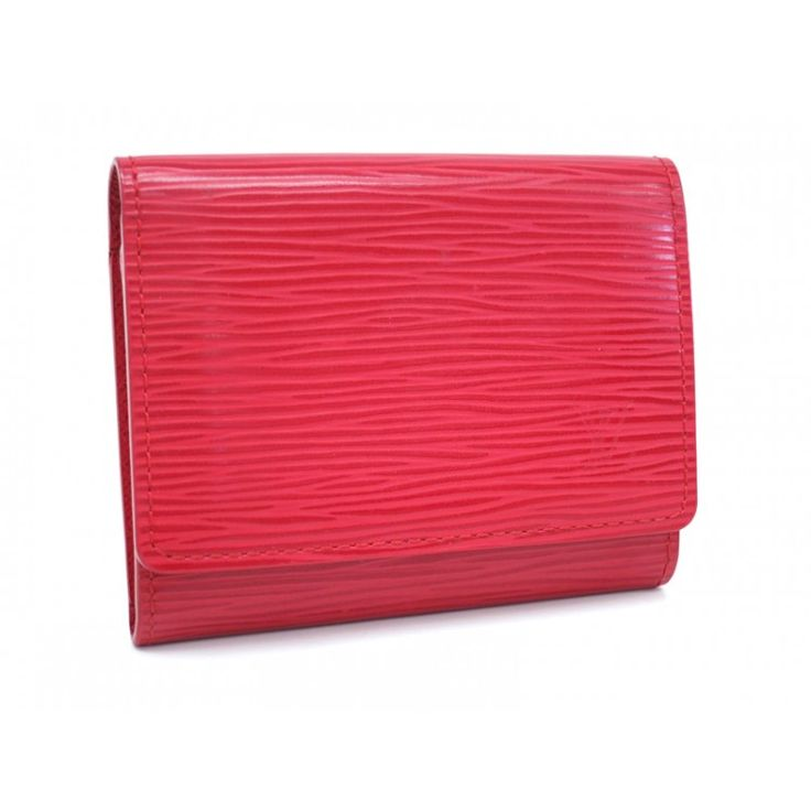 This authentic LOUIS VUITTON Business Card Holder is finely crafted from red epi leather. The inerior opens to a red leather.You can organize your business or credit cards in style with this classic design by LOUIS VUITTON. It features several compartments for sliding cards or cash into and can easily be slipped into a pocket or any handbag. A superb accessory for personal or business use. For more items like this visit https://www.swayy.com.au/