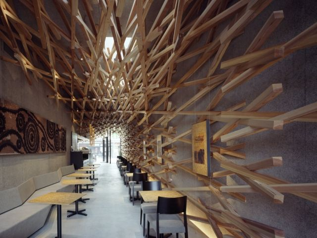 starbucks by kengo kuma. in a striking move away from traditional starbucks design, architect kengo kuma has completed work on the starbucks in fukuoka, japan. the starbucks shares a locality with a holy shrine, the dazaifu tenmagu, and kuma ensures the store design acknowledges this, with a nod towards traditional carpentry.a forest of intersecting wooden blocks branch inside and out, suggesting that the store is nestled in trees, giving off an ambience which lends itself to its…