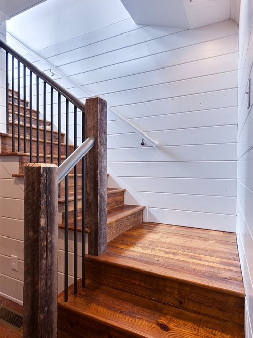 Rustic wooden stairs, shiplap walls