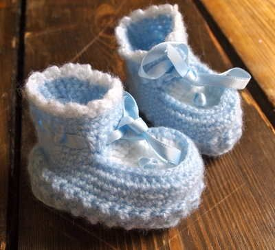 Vintage Hand Knitted Blue  White Booties 8.00 Beautiful hand knitted booties in blue and white. Lovely boot shape style with tie ribbon detail.  Size - Newborn  Coordinate with some of our childrens accessories