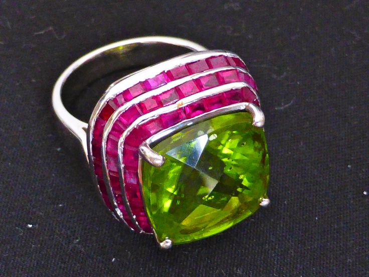 A Summer ring using radiant Rubies and a particularly grassy green Peridot - reminds me of an English summers day.
