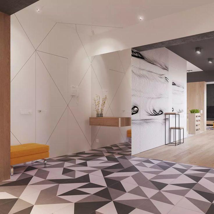 Porta d'ingresso con piastrelle geometriche in bianco e nero abbinati a grandi pannelli bianchi che rivestono le pareti - appartamento nordico