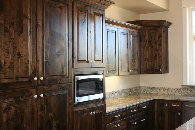 Rustic base cabinets for sale knotty alder cabinets for Black stained cabinets