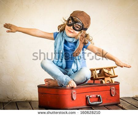 Happy kid playing with toy airplane by Sunny studio, via Shutterstock