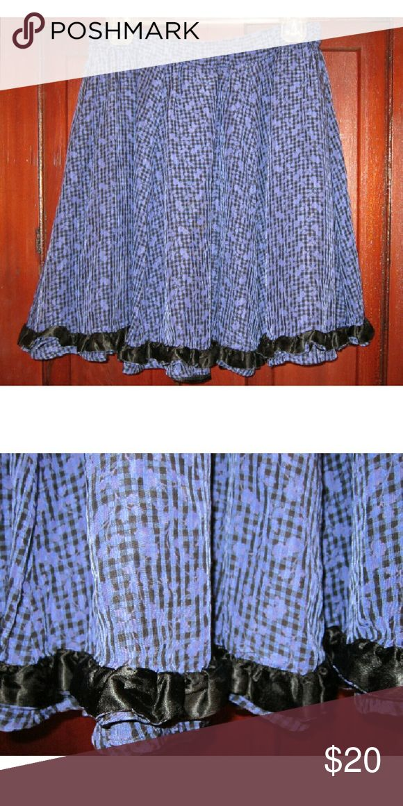 "Benetton 42 S M Flared Skirt Velvet Trim Goth Blue Pretty skirt from United Colors of Benetton in a size 42.  Should fit many US Smalls and Mediums well because it has an elastic waistband with give and take.  Done in a small black and blue checkered pattern with pretty light purple look solid floral overlays for a subtle and pretty contrast.  Inner lining.  Black velvet trim around the bottom of the skirt.   13 1/2"" waist doubled to 27"" with elastic waistband allowing for more room.  19""…"