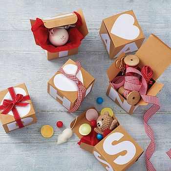 Such a cute way to present a gift to someone. in boxes with letters that spell out their name!