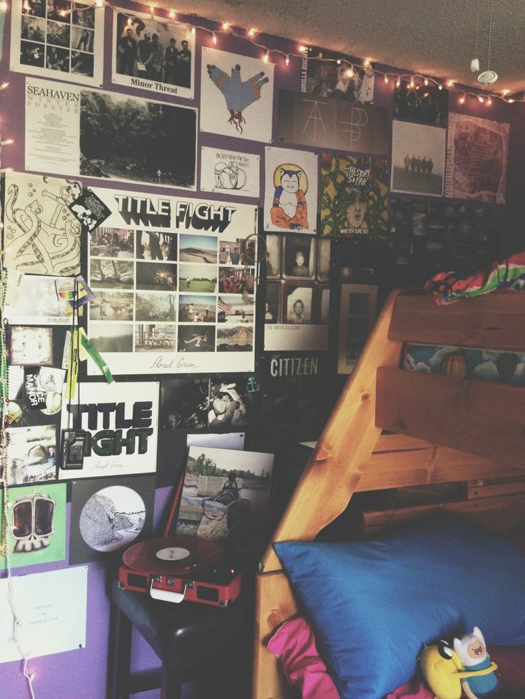 Fill your wall with favorite pictures, posters and Christmas lights.