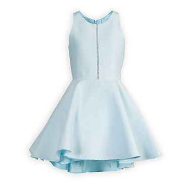 Ice Blue Sparkle Tween Party Dress The perfect party dress with front rhinestone detail and modern racer style back. Waisted dress in a soft silk/cotton blend has a full swing style skirt that dips slightly lower in back. Zip back closure. Fully lined. Above knee length. Dry clean. USA made.