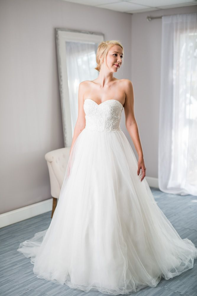 Davids Bridal - WG3633 - We love how elegant this David's Bridal gown is! The lace bodice with detailed beading intertwined throughout beautifully flows into the simple but elegant A-line train. It's simply stunning!